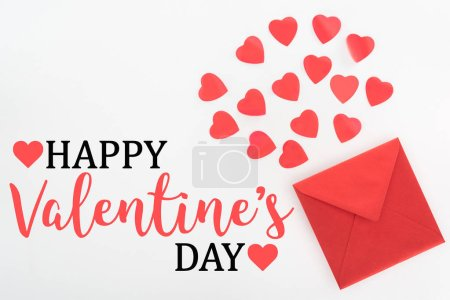 elevated view of heart symbols and red envelope isolated on white, happy valentines day