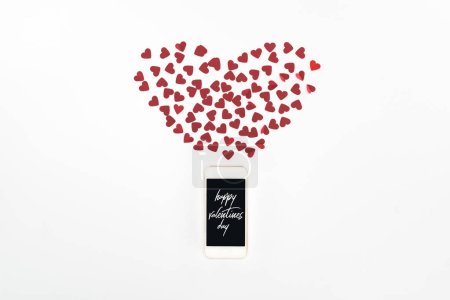 """Photo for Flat lay with red heart symbols and smartphone with """"Happy valentines day"""" lettering isolated on white, st valentine day concept - Royalty Free Image"""