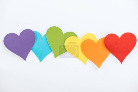 rainbow colored paper hearts on grey background, lgbt concept
