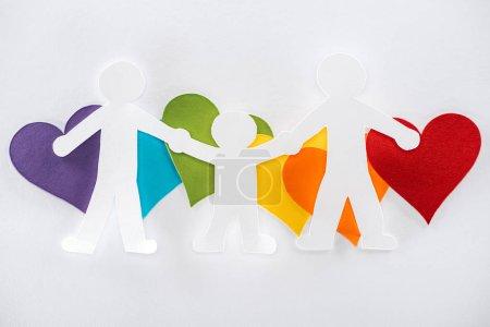 Photo pour Paper cut family and rainbow multicolored paper hearts on grey background, lgbt concept - image libre de droit