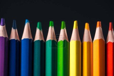 Photo pour Sharpened rainbow multicolored pencils isolated on black, lgbt concept - image libre de droit