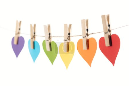 Photo pour Selective focus of rainbow multicolored paper hearts on rope isolated on white, lgbt concept - image libre de droit