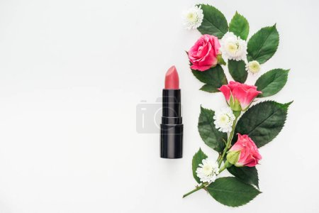 top view of flowers composition with lipstick isolated on white
