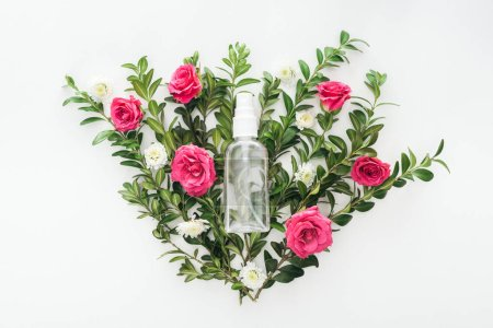 Photo for Top view of flowers composition with pink roses, green boxwood and empty spray bottle on white background - Royalty Free Image