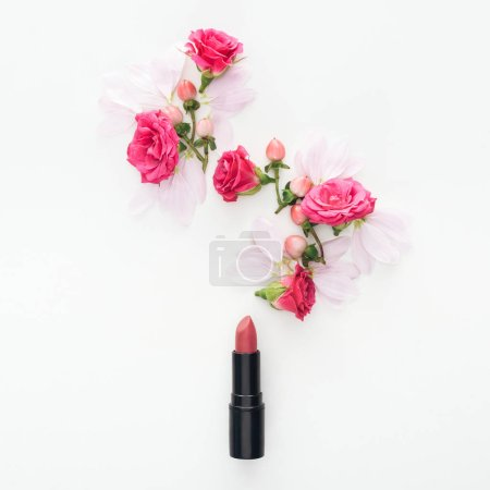 Photo for Top view of composition with roses buds, berries, petals and lipstick isolated on white - Royalty Free Image