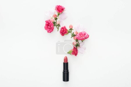 Photo for Top view of composition with roses buds, berries, petals and pink lipstick on white background - Royalty Free Image