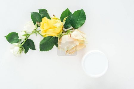 Photo for Top view of composition with roses and beauty cream in bottle on white background - Royalty Free Image