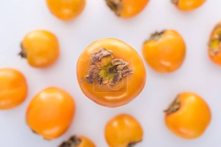 Photo for Selective focus of sweet and whole persimmons on white background - Royalty Free Image