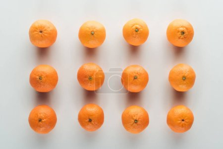 Photo for Flat lay with bright ripe orange tangerines on white background - Royalty Free Image