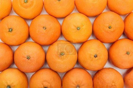 Photo for Top view of whole ripe tangerines on white background - Royalty Free Image