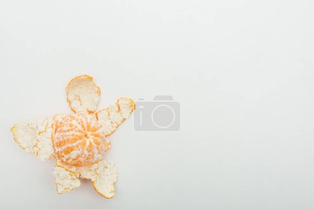 Photo for Top view of ripe orange tangerine with peel on white background - Royalty Free Image