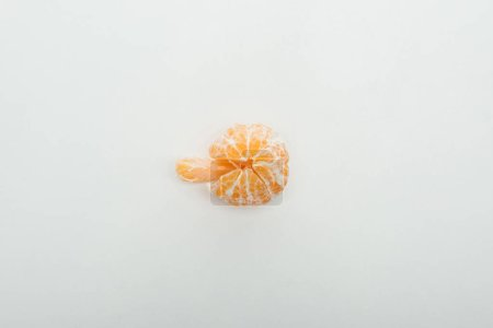 Photo for Top view of whole peeled tangerine and slice on white background with copy space - Royalty Free Image