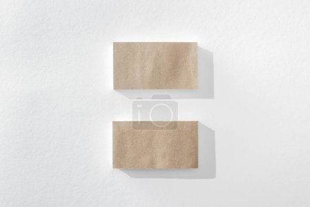 Photo for Top view of empty brown cards on white background with copy space - Royalty Free Image