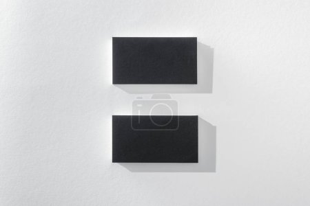 Photo for Top view of black cards on white background with copy space - Royalty Free Image