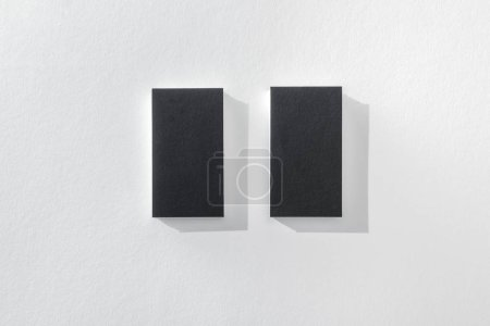 Photo for Top view of black empty cards on white background with copy space - Royalty Free Image
