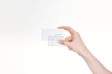 cropped view of woman holding empty card isolated on white