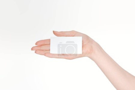 partial view of woman holding blank card isolated on white