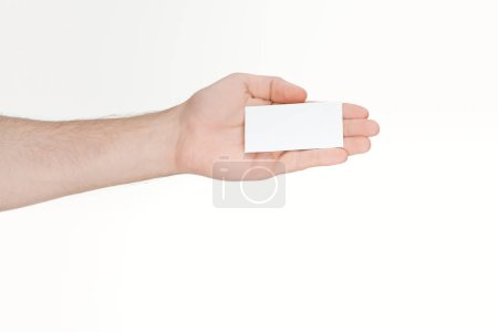 cropped view of man holding blank card on white background