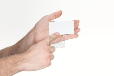 cropped view of man holding blank and empty card isolated on white