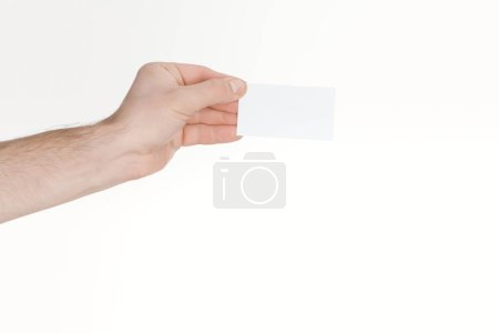 Photo for Cropped view of man holding empty card on white background - Royalty Free Image