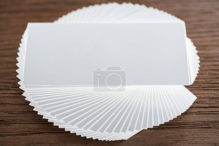 Photo for Close up of empty card on wooden table with copy space - Royalty Free Image