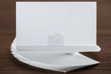 Photo for Close up of empty and blank card on wooden table with copy space - Royalty Free Image