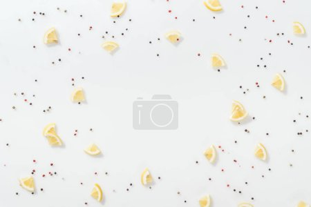 Photo for Flat lay of lemon slices near red and black peppercorns isolated on white - Royalty Free Image