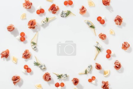 Photo pour Flat lay of sliced pears with blue cheese and rosemary twigs near prosciutto, and healthy ingredients on white background - image libre de droit