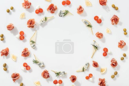 Photo pour Flat lay of sliced pears with blue cheese and rosemary twigs near prosciutto, and organic ingredients on white background - image libre de droit