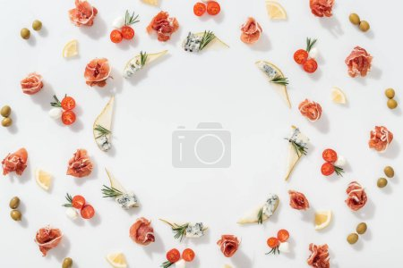 Photo pour Top view of sliced pears with blue cheese and rosemary twigs near prosciutto, and organic ingredients on white background - image libre de droit