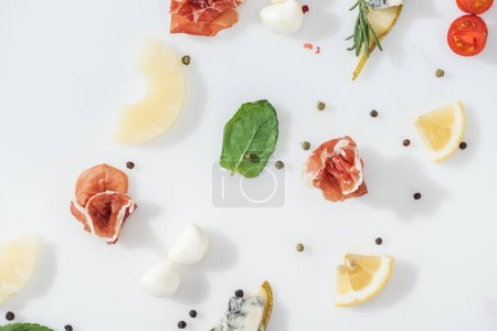 Photo for Flat lay of delicious prosciutto near fresh ingredients and spices on white background - Royalty Free Image