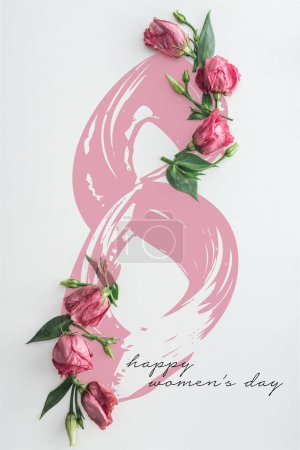 Photo for Top view of pink roses on white background with happy womens day lettering - Royalty Free Image