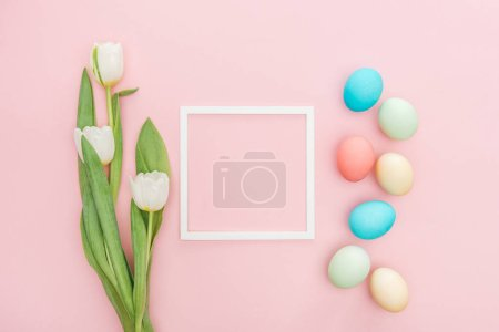 Photo for Top view of tulip flowers and easter eggs with frame isolated on pink - Royalty Free Image