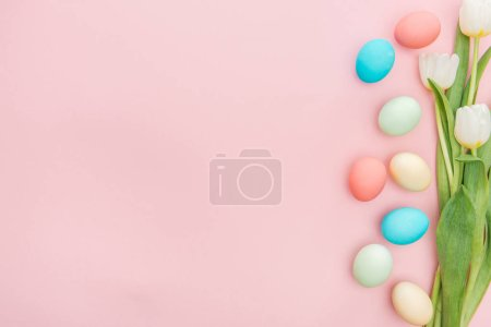 Photo for Top view of tulip flowers and easter eggs isolated on pink with copy space - Royalty Free Image