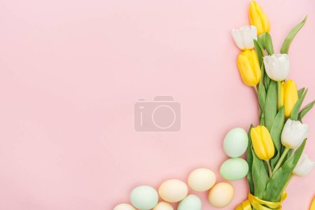 Photo for Top view of tulips and pastel easter eggs isolated on pink - Royalty Free Image