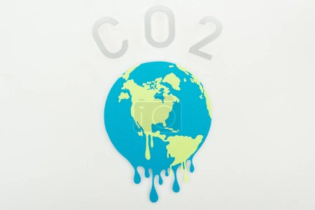 Photo for Melting paper cut globe and co2 lettering on grey background, global warming concept - Royalty Free Image