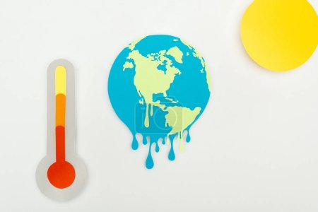Photo for Paper cut sun and melting earth, and thermometer with high temperature indication on scale on grey background, global warming concept - Royalty Free Image