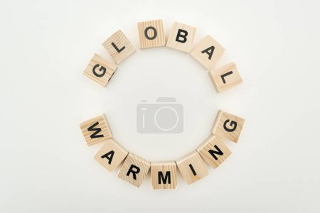 "Photo for Wooden cubes arranged in circle with ""global warming"" lettering on grey background - Royalty Free Image"