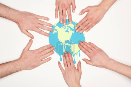 partial view of women and men putting hands on paper cut melting globe on white background, global warming concept