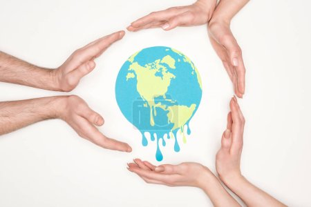 Photo for Cropped view of women and men surrounding paper cut melting globe with hands on white background, global warming concept - Royalty Free Image