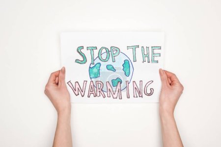 """Photo for Partial view of woman holding card with melting globe sign and """"stop the warming"""" lettering on white background - Royalty Free Image"""