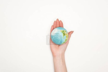 partial view of female hand with earth model on white background, global warming concept