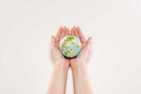 Photo for Cropped view of female holding earth model on white background, global warming concept - Royalty Free Image