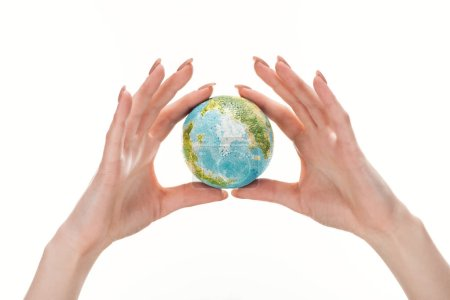 Photo for Partial view of woman holding earth model isolated on white, global warming concept - Royalty Free Image
