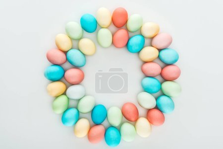 Photo for Top view of traditional easter eggs in circle isolated on grey - Royalty Free Image