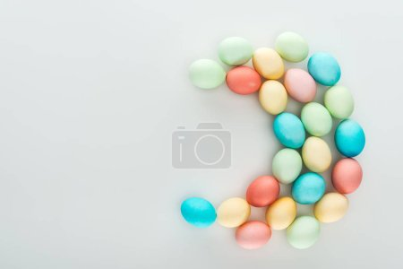 Photo for Top view of pastel colorful easter eggs isolated on grey - Royalty Free Image