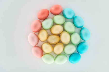 Photo for Top view of pastel easter eggs isolated on grey - Royalty Free Image