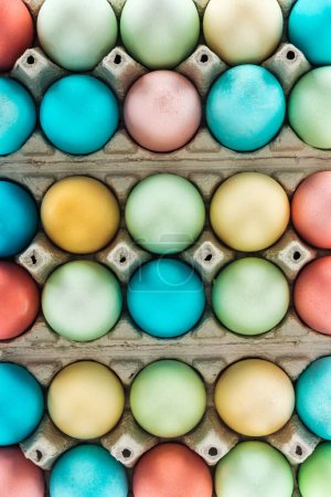 Photo for Top view of traditional colorful easter eggs in paper containers - Royalty Free Image