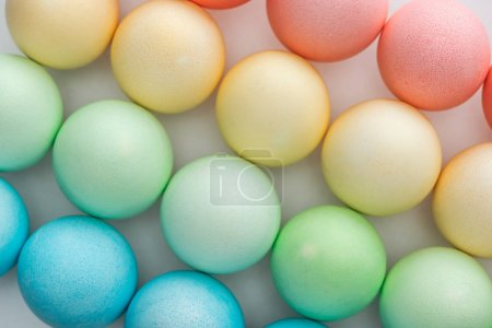 Photo for Top view of colorful painted easter eggs on grey - Royalty Free Image