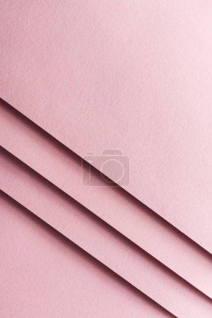 Foto de Vista superior de vacías y coloridas hojas de papel en fondo rosa con espacio de copia - Imagen libre de derechos
